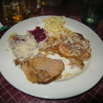 Clockwise form the top: spaetzle, rouladen, sauerbraten, mashed potatoes, and clove flavored red cabbage
